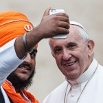 October 28 2015 : Pope Francis poses for a selfie with a member of the inter-religious community during the weekly audience in Saint Peter's Square at the Vatican.